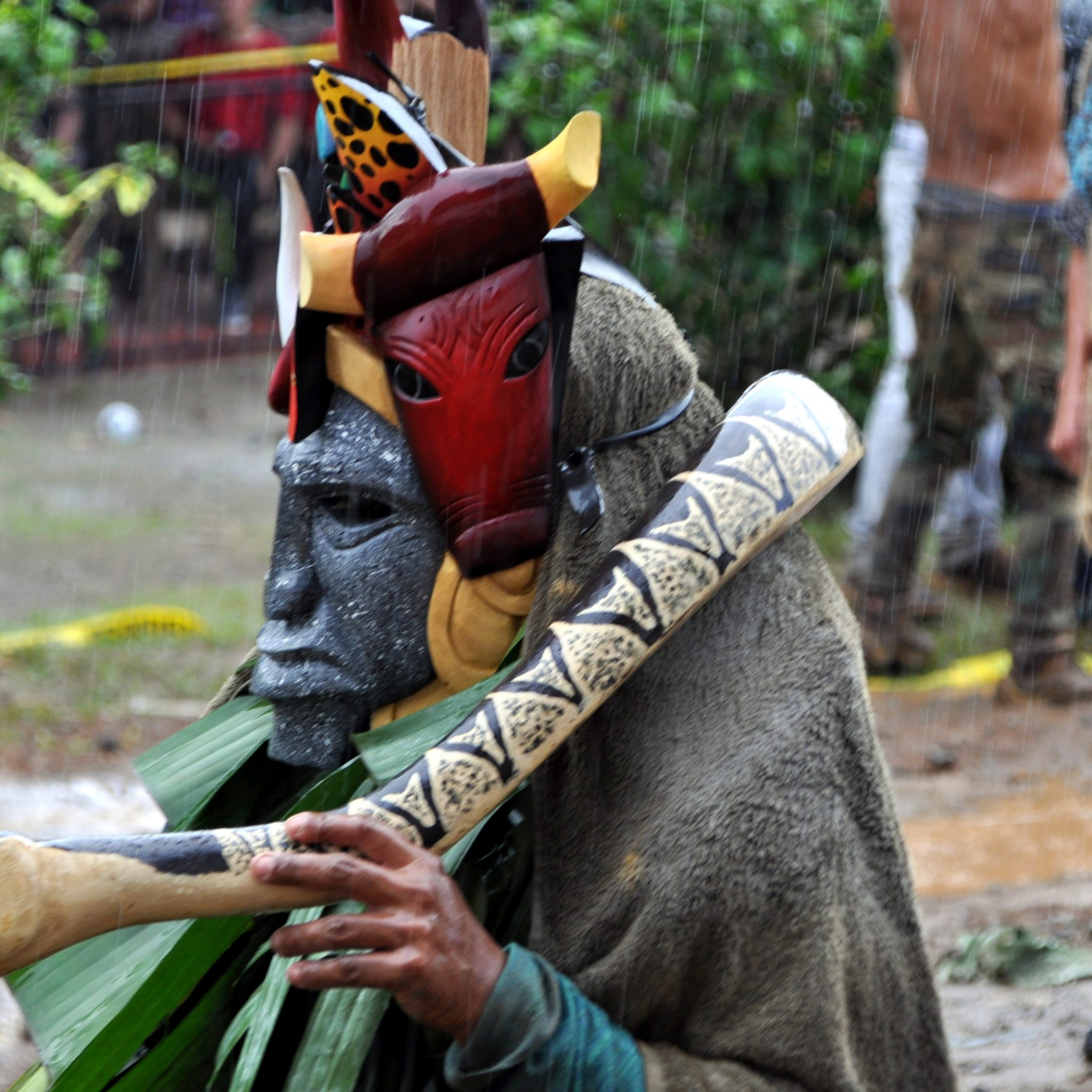 Rain pouring down on meticulously hand painted masks during the 'battle'.